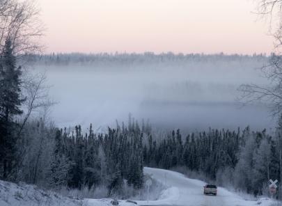 winter winding road in alaska mountains
