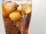 glass of cola with ice and lots of bubbles