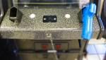 blue gun in arcade game holster