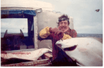 man on fishing boat with large fish
