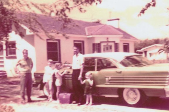 old family photo kids with daddy by car
