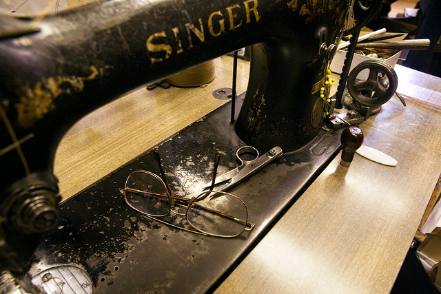 Sewing Machine with mans glasses
