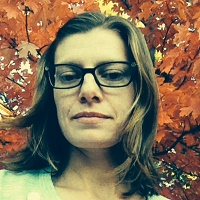 katrina knebel in front of fall tree