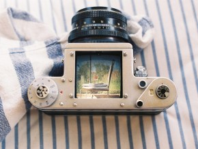 a camera with a photo of a motel chair in its viewfinder