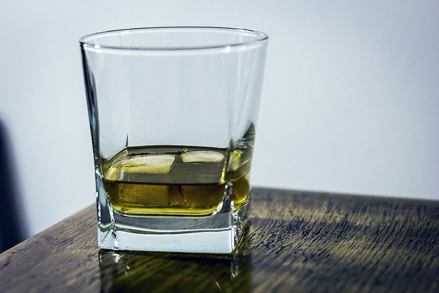whiskey on glass on wooden table
