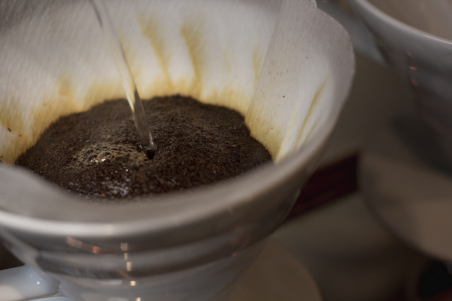 pour-over coffee close-up shot of grounds and filter