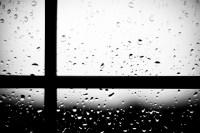 close-up of window with rain drops; window pane left of center
