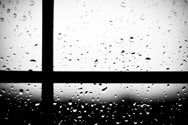 close-up of window with rain drops; window pane left of center