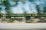 fast-moving train as depicted by blur - you can see people on steps by doors