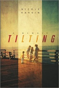 tilting cover family on pier looking at ocean