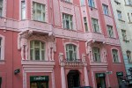 pink apartment building in prague nice architectural detail