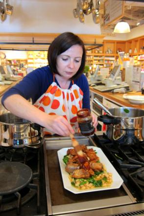 Laura Pazzaglia, founder of hip pressure cooking, brushes the last bit of BBQ sauce on pressure cooked ribs before broiling.