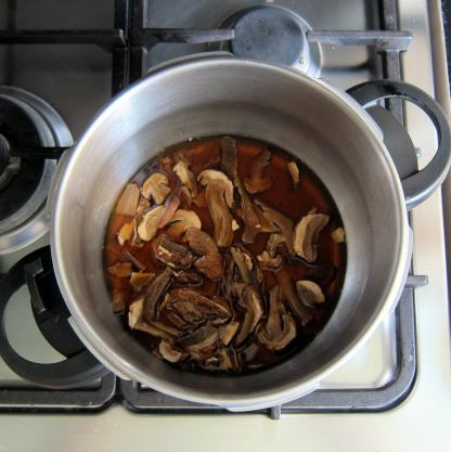 Add re-hydrated mushrooms and their liquid to the pressure cooker.