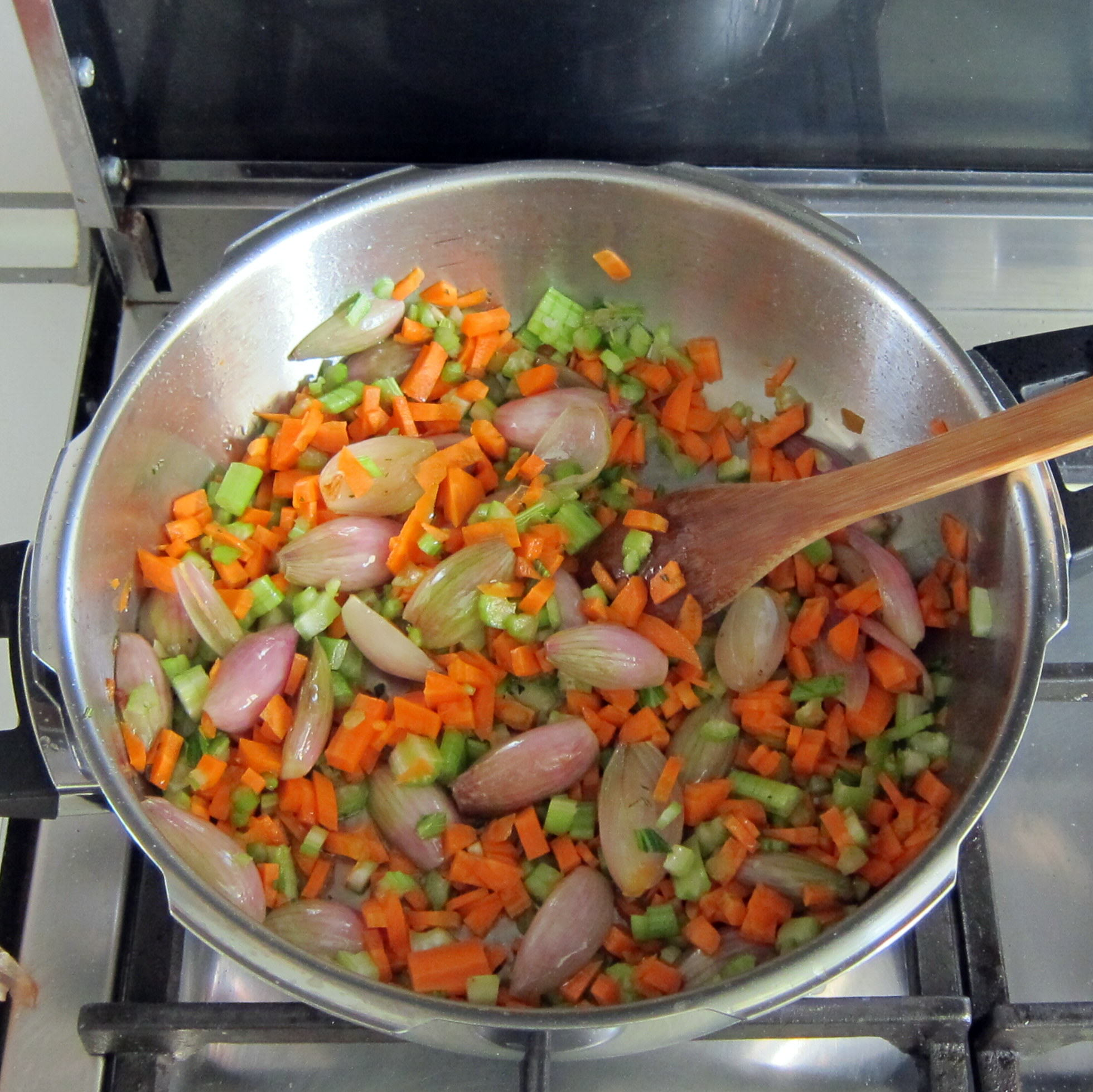 Mix-in shallots, celery and carrots. Saute until shallots are starting to soften.