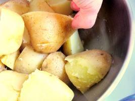 Grab a corner of each potato slice...