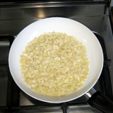 Toast almond flakes on medium heat, in a saute pan.