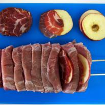 Between each cut add a slice of apple and coppa.