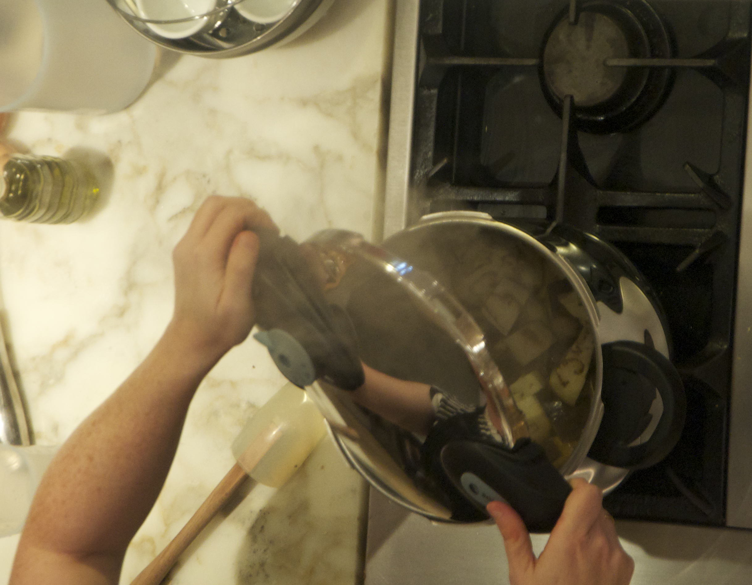 Finished pressure cooking eggplant. Tilt the lid away from you (towards the audiance)!