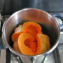 Quarter and steam pumpkin before peeling.