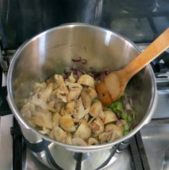 Add enough roughly sliced mushrooms to cover the base and brown.