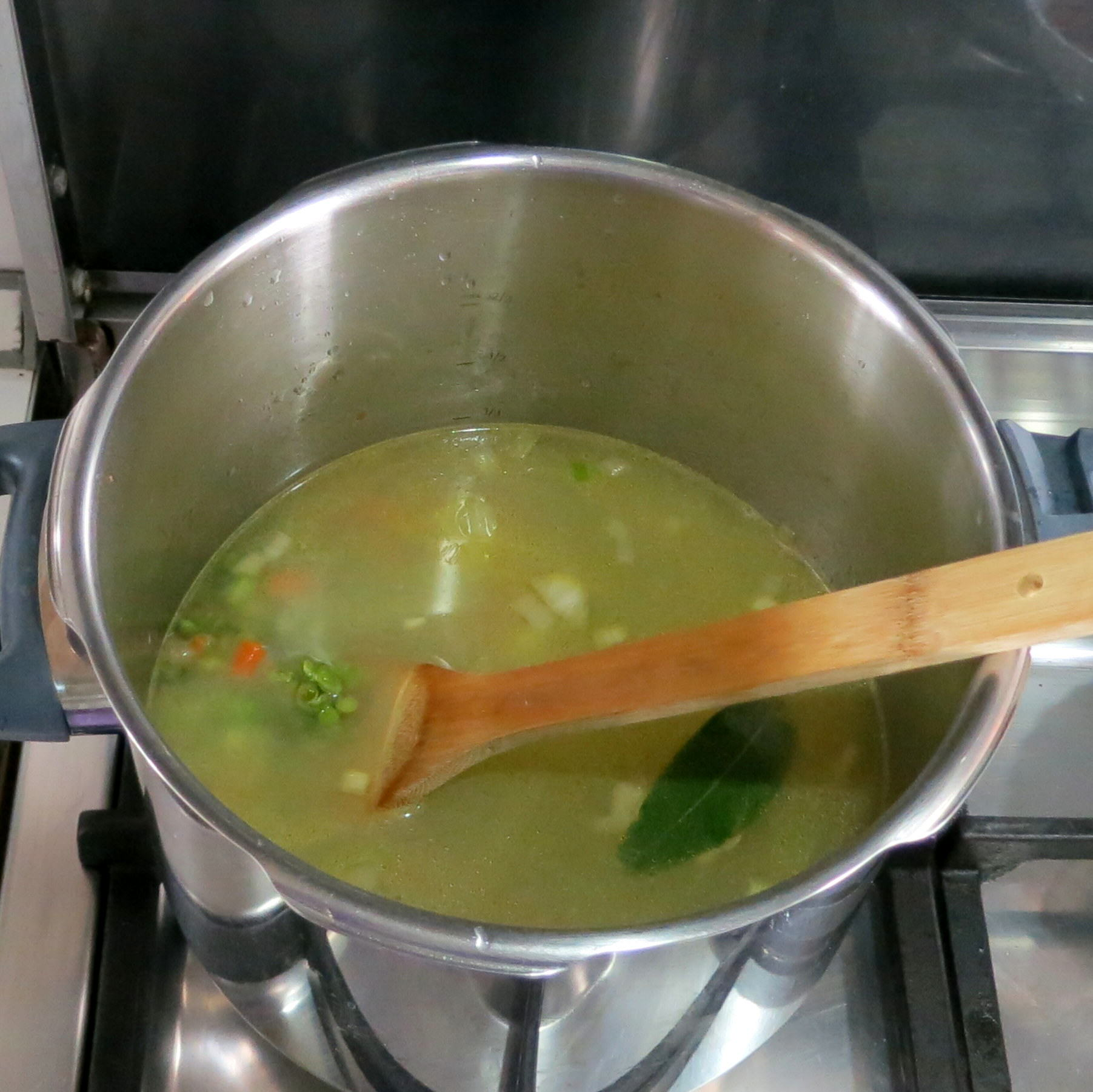 Add water, spit peas, bay leaf and salt.