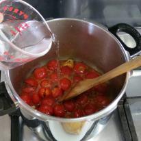 Add garlic, wine, salt, oregano, hot pepper and water.