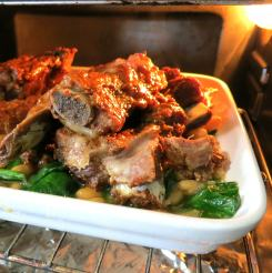 Broil casserole until the sauce bubbles and caramelizes on the ribs.