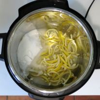 Add strips, fresh water and sugar, bring to a boil and pressure cook.