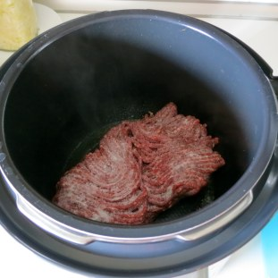 Brown ground meat - if frozen brown both sides of block.