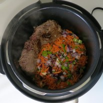 Push meat aside and add veggies, salt and pepper.