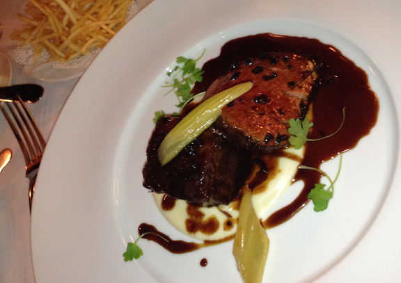 Le Crocodile anniversary duo of prime rub and tenderloin with celery root purée and black truffle port wine jus