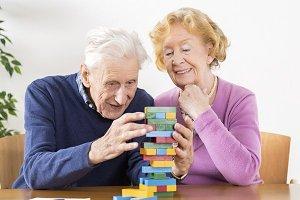 happy senior couple playing jinga