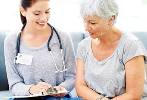 A doctor explaining positive test results to a smiling senior patient