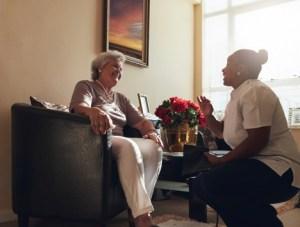 caregiver talking with senior woman