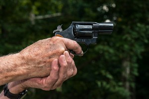 Senior with dementia holding a firearm
