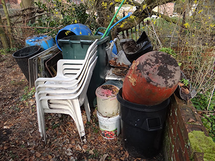 old plastic water butts and garden chairs on our allotment