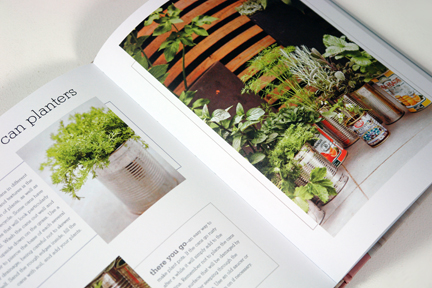 page from Homemade Home book showing upcycled planters made from food tins