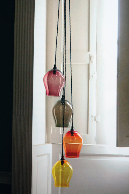long pendant ceiling light with four different coloured glass shades