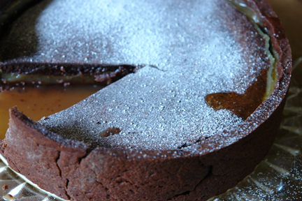 chocolate and salted caramel tart with one slice removed