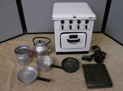 child's vintage Heiliger oven with utensils