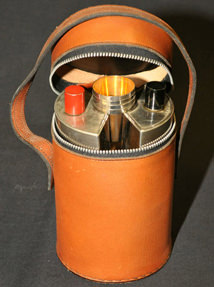 Vintage twin hip flasks in leather case with metal cups being sold on eBay by North Devon Hospice