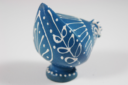 rear detail from a small blue slipware pottery figure of a chicken
