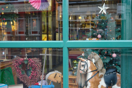 vintage Christmas decorated shop window of Picture House Antiques in Todmorden