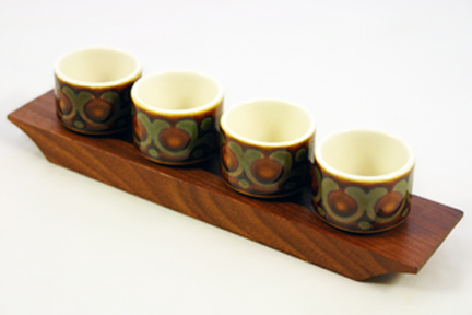 set of vintage Hornsea 'Bronte' egg cups on teak under tray