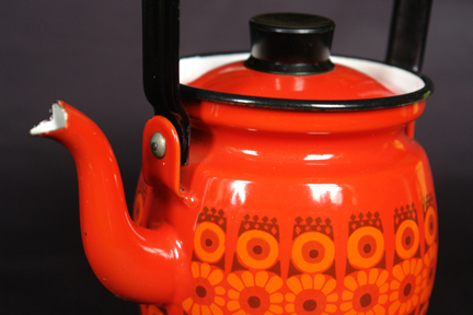 detailed view of a red, vintage Finel enamel kettle