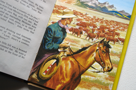 "page from the vintage 1959 Ladybird book, ""Flight three, U.S.A. - A Ladybird Book of Travel Adventure"" showing a cowboy on horseback rounding up cattle"