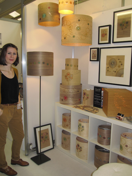 Jane Blease standing beside her stall at the 2011 British Craft Trade Fair