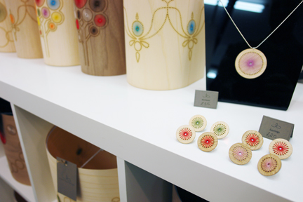 a display of Jane Blease's handcrafted wooden jewellery