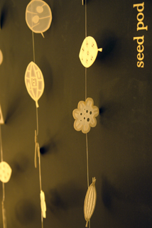 detail of the display of Hannah Nunn's Radiance newly designed seedpod window/wall hanging