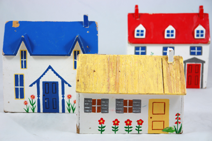 three vintage hand painted wooden houses